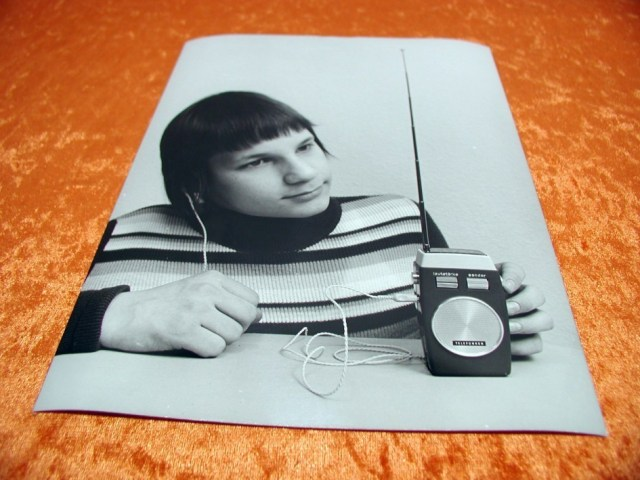 kid with earphone and transistor radio
