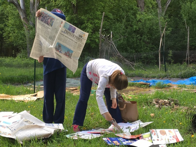 Enlisting bookworms to spread newspaper for mulch has consequences